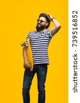 young hipster man posing with... | Shutterstock . vector #739516852