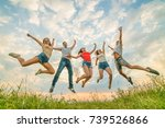the happy people jumping on the ... | Shutterstock . vector #739526866