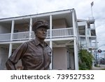 Small photo of 2016 Fredericksburg, January 5, Texas, USA: closeup of the admiral Nimitz statue in the front of the museum named after him