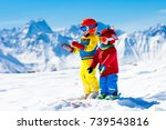 child skiing in the mountains.... | Shutterstock . vector #739543816
