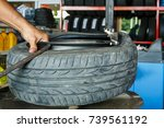 Small photo of Machine for removing rubber from the wheel disc How to remove the tire from the car Alloy Wheels.