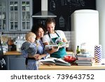 young family preparing lunch in ... | Shutterstock . vector #739643752