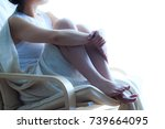 lonely woman sitting in a chair ... | Shutterstock . vector #739664095