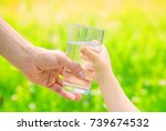 the father gives the child a... | Shutterstock . vector #739674532