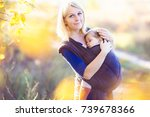 young mother carrying her baby... | Shutterstock . vector #739678366