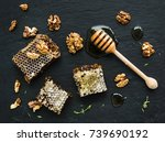 honeycomb  walnuts and honey... | Shutterstock . vector #739690192