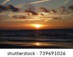 sundown at the north sea coast... | Shutterstock . vector #739691026