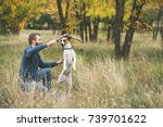 owner playing with dog and... | Shutterstock . vector #739701622