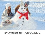 parents and child build snowman ... | Shutterstock . vector #739702372