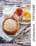 bowl full of oats with milk and ... | Shutterstock . vector #739741888