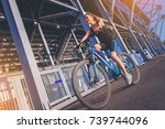 sporty girl cyclist riding a... | Shutterstock . vector #739744096