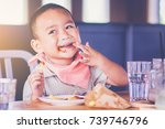 little boy enjoy eating french... | Shutterstock . vector #739746796