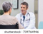 doctor talking to woman in...   Shutterstock . vector #739764946