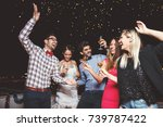 group of people having a party... | Shutterstock . vector #739787422