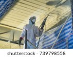 technician spraying foam... | Shutterstock . vector #739798558