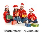 Happy Family In Santa Hats Wit...