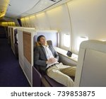 relaxed mid adult business man... | Shutterstock . vector #739853875