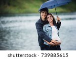 Pregnant Woman And Man Holding...