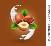 hazelnuts in milk splash.... | Shutterstock .eps vector #739922308