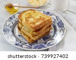 french toast served with honey...   Shutterstock . vector #739927402