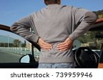 man with back pain after long... | Shutterstock . vector #739959946