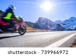 motorbike at the grossglockner mountain - blurred motion - stock photo