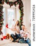 parents sit with their children ...   Shutterstock . vector #739991416