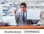 businessman  in office holding... | Shutterstock . vector #739998442
