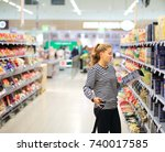 woman shopping in supermarket... | Shutterstock . vector #740017585