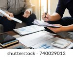 group of successful business... | Shutterstock . vector #740029012