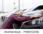 a happy young man hugging his...   Shutterstock . vector #740031658