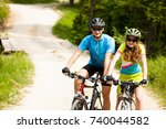 active young couple biking on a ... | Shutterstock . vector #740044582