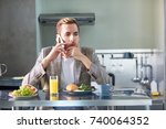 pensive man speaking on... | Shutterstock . vector #740064352