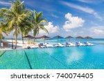 luxury poolside with sun beds... | Shutterstock . vector #740074405