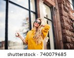 pretty girl wearing sunglasses... | Shutterstock . vector #740079685