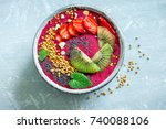 Small photo of Acai smoothie bowl with chia seeds, fruits, berries (strawberries) and bee pollen for healthy vegan vegetarian diet raw breakfast. Breakfast smoothie bowl on white background, copy space.