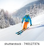 skier skiing downhill during... | Shutterstock . vector #740127376