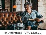 mature handsome man looking at... | Shutterstock . vector #740133622