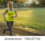 runner woman running in stadium ... | Shutterstock . vector #740137732
