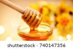 honey dripping from honey... | Shutterstock . vector #740147356