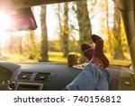 autumn car trip. woman feet in... | Shutterstock . vector #740156812