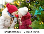 two adorable little sisters... | Shutterstock . vector #740157046