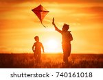 children launch a kite in the... | Shutterstock . vector #740161018