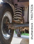 Small photo of Rear suspension and differential of a car