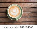 top view of hot coffee in green ... | Shutterstock . vector #740183368