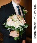 wedding bouquet in groom's hands   Shutterstock . vector #740190136