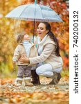 mom and daughter under the... | Shutterstock . vector #740200132