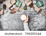 hands holding a cozy mug with... | Shutterstock . vector #740205166