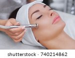the cosmetologist makes the... | Shutterstock . vector #740214862