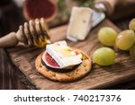 cheese crackers with camembert... | Shutterstock . vector #740217376
